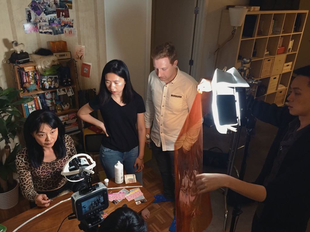 Alexey Marfin, Shirley To, and Vivian Xin Zhen on the set of Kowloon Forest